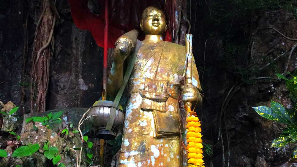 Gold statue in the jungle