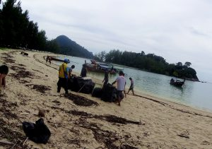 plastic bags local staff clean beach cleaning khao lak thailand